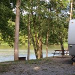 A lakefront RV site at Soaring Eagle Campground
